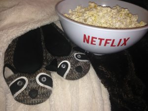 We love a good family movie night. Snacks, cozy fur blankets, and favourite slippers are essential.