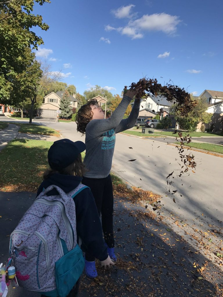 Maddy lives for throwing leaves in the fall, from early August, when they are really just leave corpses from the year before, right up to when she would need a chisel to get them off the ground.