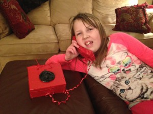 """Molly and Grace are in a skit about the eighties, so Molly made this rotary phone. They insist that watching Full House is """"research."""""""